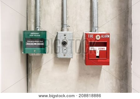 push in pull down switch in case of fire and emergency door release switch against concrete background