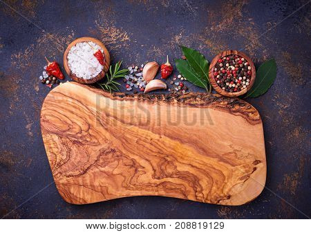 Cutting board with herbs and spices. Culinary background. Top view