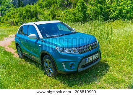 Montenegro, Prokletije Mountains - May 29/2017: Tourists In Suzuki Vitara Car Went On A Trip To The