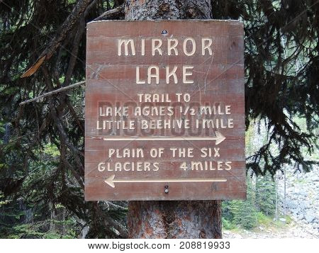 Trail Sign for Mirror Lake, Lake Agnes, Little Beehive, and Plain of Six Glaciers close to Lake louise, in Banff national park, Alberta, Canada
