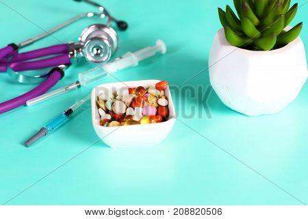 Medicine pills, tablets and capsules on table.