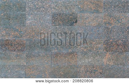 Black granite tiles with disseminations of red stones as background or texture