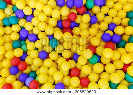 Multiplicity multi-colored plastic balls for playing children as background