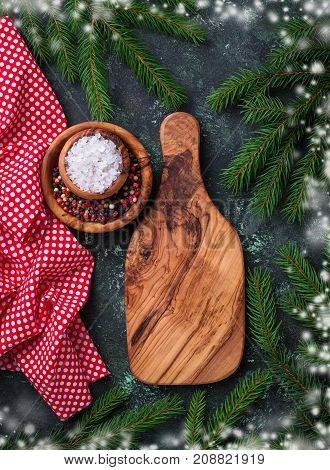 Christmas cooking background with cutting board and spices. Top view, space for text