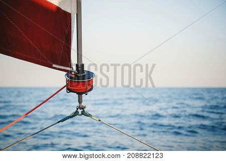 Sailboat winch, sail and nautical rope yacht detail. Yachting, marine background.