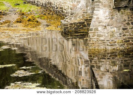 Abstract of water under the bridge at Eilean Donan Castle