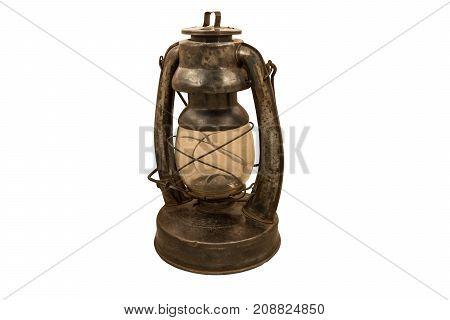 Old Rusty Kerosene Lamp On A White Background