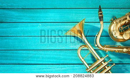Saxophone and trumpet are placed on the old blue wood floor.