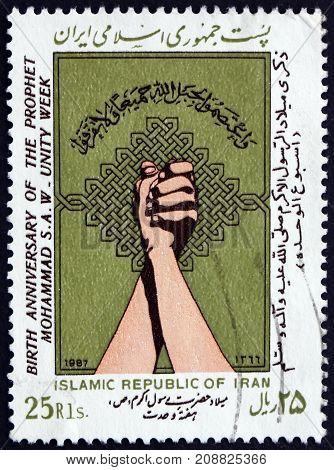IRAN - CIRCA 1987: a stamp printed in the Iran dedicated to Unity Week Mohammad's Birthsay circa 1987