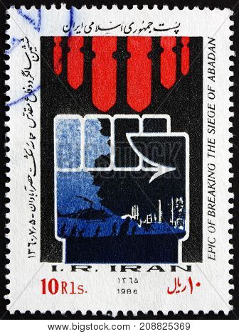 IRAN - CIRCA 1986: a stamp printed in the Iran dedicated to Epic of Breaking the Siege of Abadan Iran-Iraq War circa 1986