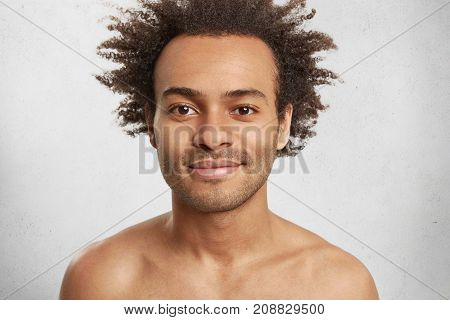 Close Up Portrait Of Condifent Dark Skinned Male With Bristle Has Crisp Hair And Full Lips, Being Na