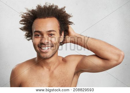 Headshot Of Attractive African American Guy With Bushy Hairstyle, Being Naked, Glad To Have Sport Tr