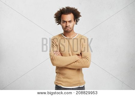 Waist Up Portrait Of Sullen Grumpy Man With Bristle And Curly Hair, Keeps Arms Folded, Has Sullen Ex