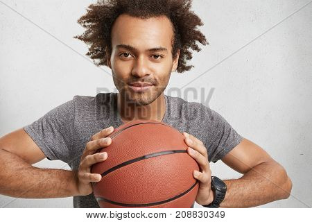 Dark Skinned Mixed Race Male Advertises Basketball. Handsome Attractive Unshaven Male Player Waits F