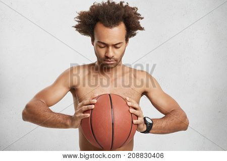 Serious Concentrated Basketball Player Holds Ball, Prays For Good Luck During Game, Wishes Triumph A
