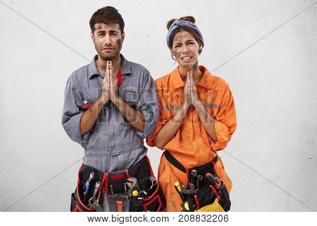 Begging Tired Electricians Want To Have Rest, Ask Boss For Spare Time Or Weekend, Press Palms Togeth