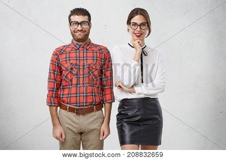 Weird Couple In Love Don`t Know How Behave On First Date, Smile Pleasantly, Stand Close To Each Othe