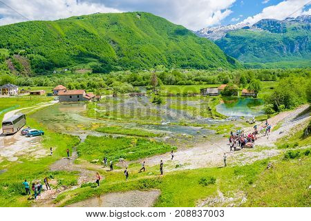 Montenegro, Gusinje - May 29/2017: A Group Of Tourists Visit The Famous Sources Of Ali Pasha Near Th