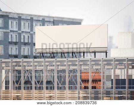 Blank billboard on the roof of modern building. 3d rendering