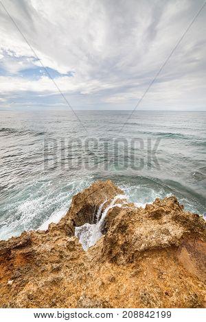 Waves crashing to rock at Manzanillo Costa Rica