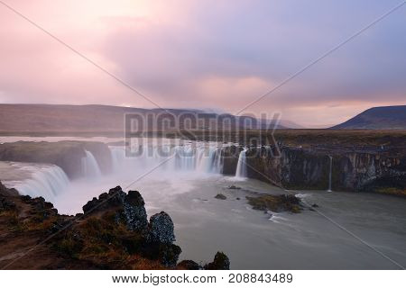 Stormy sunset over Godafoss Waterfall Iceland north