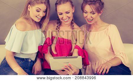 Three Women Using Tablet