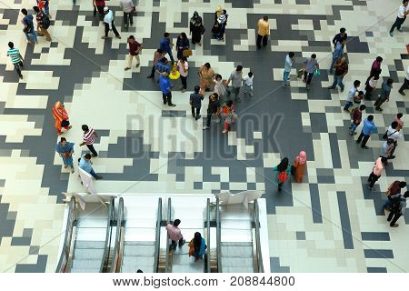 Dhaka, bangladesh, september 2017-people are walking on beautiful texture on floor located at bashundhora shopping market located at pathopath in dhaka in bangladesh taken on 17th september 2017.