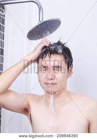 Man Are Taking A Rain Shower And Washing Hair In Bathroom
