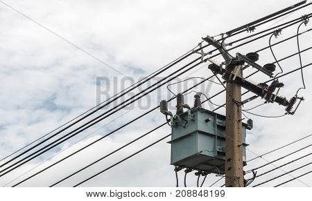 electricity post on cloudy sky view background