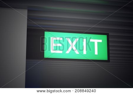 Green illuminated EXIT sign on dark background closeup. Way out of building at airport hotel hospital or office. 3D illustration