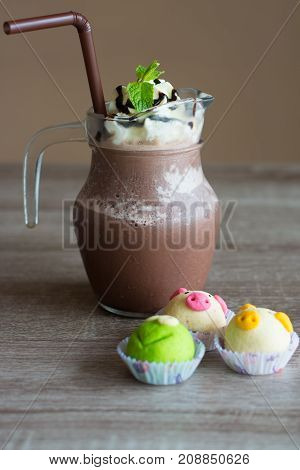 Iced coffee in glass and cookies fancy on wooden table