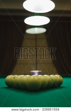 Balls on the table for billiard game called Russian pyramid