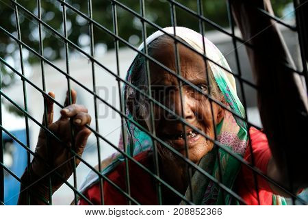 Dhaka, bangladesh, October 2017-an ole street beggar asking for moeny at street located at pathopath in dhaka in bangladesh taken on 17th september 2017