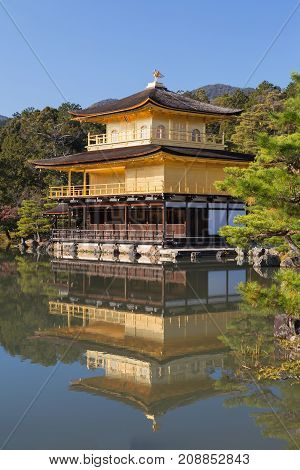 Kinkakuji golden pavilion with water reflection with clear blue sky background Kyoto Japan landmark