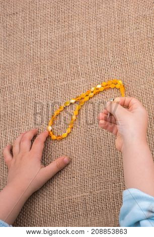 Praying Beads Of Various Color In Hand