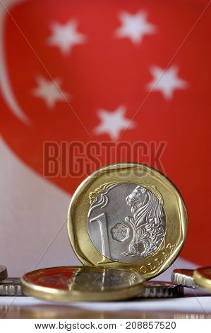 Singaporean coins with background of the flag of Singapore.