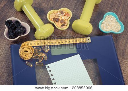 Digital Scale With Tape Measure, Tablets, Dumbbells And Healthy Nutrition, Slimming Concept