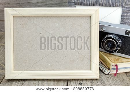 Retro Camera, Photo Frame And Notebooks On Grunge Wooden Background