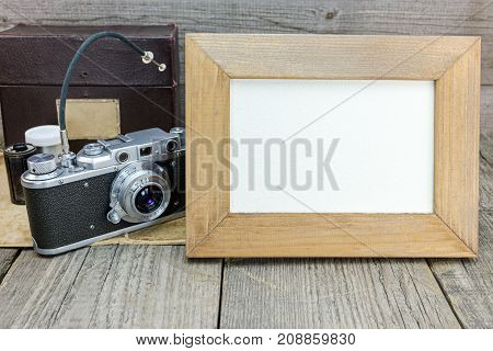 Old Classic Camera And Photo Frame On Gray Wooden Background