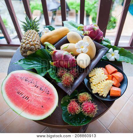 Exotic fruits, juicy, natural filming. Mango, papaya, dragon fruit, rambutan, pineapple