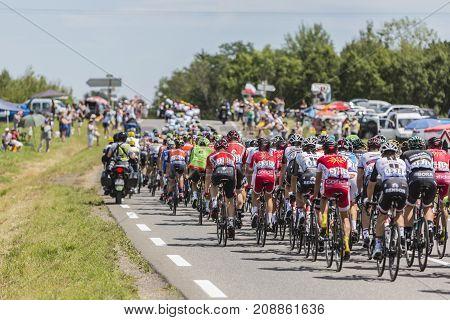 Mailleroncourt-Saint-Pancras France - July 5 2017: The rear view of the peloton riding on a road to La Planche des Belle Filles during the stage 5 of Tour de France 2017.