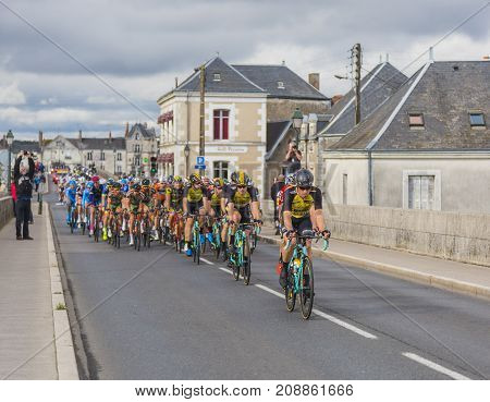 AmboiseFrance - October 82017: The peloton passing on the bridge in Amboise during the Paris-Tours road cycling race.