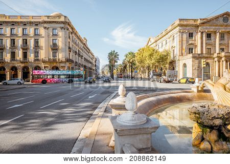 BARCELONA, SPAIN - August 16, 2017: View on the wide avenue called Passeig de Colom with fountain in Barcelona city