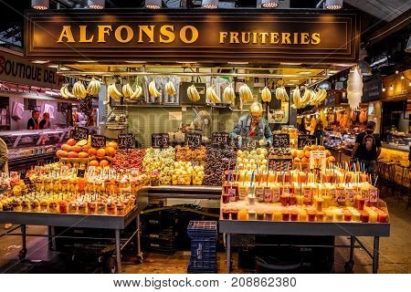BARCELONA, SPAIN - August 16, 2017: Food stores in La Boqueria market one of the most popular tourist landmarks in the Ciudad Vieja district in Barcelona