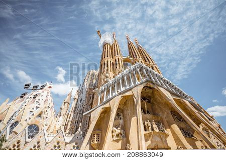 BARCELONA, SPAIN - August 16, 2017: View on the famous unfinished Roman Catholic church Sagrada Familia in Barcelona, designed by Catalan architect Antoni Gaudi