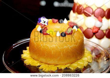 close up of orange cake and fruit