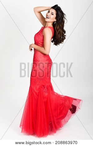 Young Woman Wearing Long Red Dress On White Background.