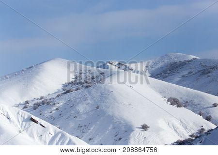 snowy slopes of the Tien Shan Mountains