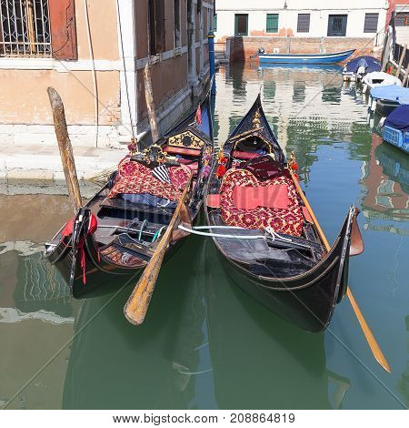 Gondola - symbol of Venice narrow side channel Venice Italy. Gondola is iconic traditional boat very popular means of transport for tourists