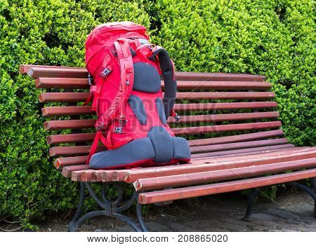 Backpack close up on the bench in the garden. Travel concept. Backpacker style